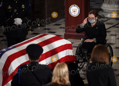 Photo - United States Senator Tammy Duckworth (Democrat of Illinois) pays her respects to the late Associate Justice Ruth Bader Ginsburg as her casket lies in state during a memorial service in her honor in the Statuary Hall of the US Capitol September 25 2020 in Washington DCCredit Olivier Douliery  Pool via CNPAdMedia