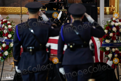 Photo - Members of US Capitol Police salute the body of their colleague US Capitol Police officer William Evans in the Rotunda of the US Capitol in Washington DC on Tuesday April 13 2021 Credit Amr Alfiky  Pool via CNPAdMedia