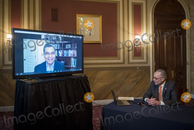 Photo - United States Senate Minority Leader Chuck Schumer (Democrat of New York) is joined virtually by Health and Human Services Secretary-designate Xavier Becerra and US Surgeon General-designate Dr Vivek Murthy during a press conference at the US Capitol