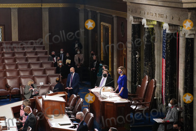 Photo - Speaker of the House Nancy Pelosi D-Calif presides over the Electoral College vote certification for President-elect Joe Biden during a joint session of Congress at the US Capitol in Washington DC on Wednesday January 6 2021  Credit Kevin Dietsch  Pool via CNPAdMedia