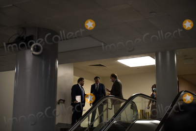 Photo - United States Senator Mitt Romney (Republican of Utah) talks with two reporters at the top of the stairs as Senators make their way through the Senate subway during a vote at the US Capitol in Washington DC Wednesday July 21 2021 Credit Rod Lamkey  CNPAdMedia