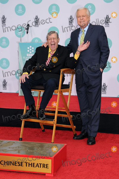 Photo - 20 August 2017 - Jerry Lewis the brash slapstick comic who became a pop culture sensation in his partnership with Dean Martin and then transformed himself into an auteur filmmaker of such comedic classics as The Nutty Professor and The Bellboy has died in Las Vegas at the age of 91 For most of his career Lewis was a complicated and sometimes polarizing figure An undeniable comedic genius he pursued a singular vision and commanded a rare amount of creative control over his work with Paramount Pictures and other studios He legacy also includes more than 25 billion raised for the Muscular Dystrophy Association through the annual Labor Day telethon that he made an end-of-summer ritual for decades until he was relieved of the hosting job in 2011 In addition to his most famous films Lewis also appeared in a number of notable works such as Martin Scorseses The King of Comedy but was largely offscreen from the late 60s on and was more active with his telethon and philanthropic efforts As late as 2016 Lewis continued to perform in Las Vegas where he first debuted his comedy routine back in 1949 File Photo 12 April 2014 - Hollywood California - Jerry Lewis Robert Osborne 2014 TCM Classic Film Festival - Jerry Lewis Hand  Footprint Ceremony held at the TCL Chinese Theatre Photo Credit Byron PurvisAdMedia
