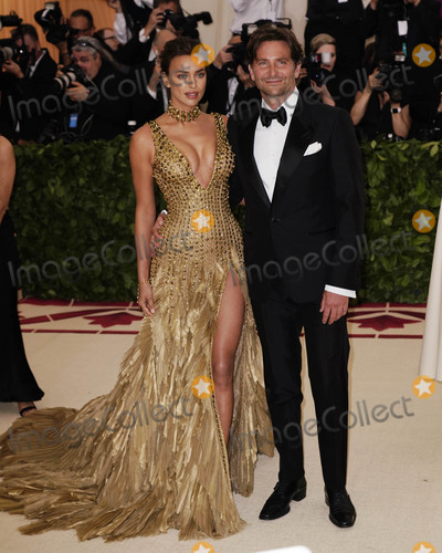 Photo - Photo by XPXstarmaxinccomSTAR MAX2018ALL RIGHTS RESERVEDTelephoneFax (212) 995-11965718Irina Shayk and Bradley Cooper at the 2018 Costume Institute Benefit Gala celebrating the opening of Heavenly Bodies Fashion and the Catholic Imagination(The Metropolitan Museum of Art NYC)