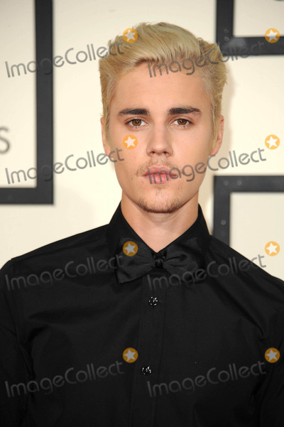 Photo - Photo by PlutostarmaxinccomSTAR MAX2015ALL RIGHTS RESERVEDTelephoneFax (212) 995-119621516Justin Bieber at The 58th Grammy Awards(Los Angeles CA)