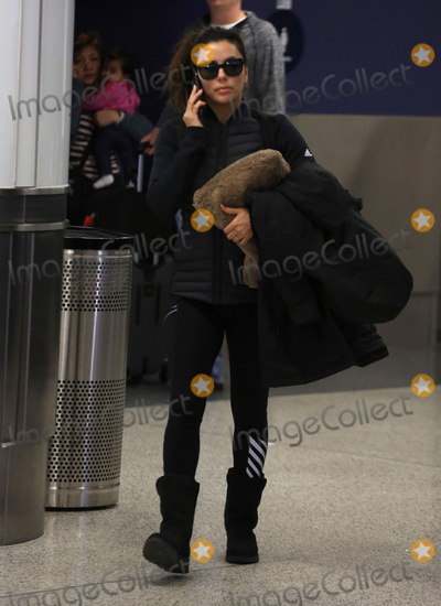 Photos From Eva Longoria is seen at LAX Airport in Los Angeles, CA - 3/14/19