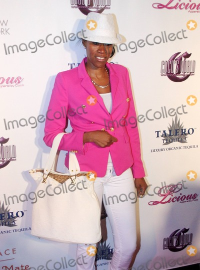 Tashera Simmons Photo - Tashera Simmons at the launch of Cocos new clothing line Coco Licious at the Grace Hotel in New York Coco hosted a small fashion show that showed off her line of pastel colored dresses New York NY 052211