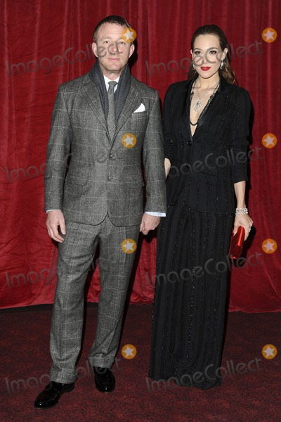 Photo - Guy Ritchie and girlfriend Jacqui Ainsley arriving for the Sherlock Holmes A Game of Shadows premiere at the Empire Leicester Square London 08122011 Picture by Steve Vas  Featureflash