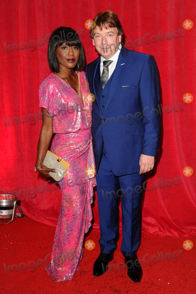 Adam Woodyatt Photo - Diane Parish and Adam Woodyatt arriving for the 2014 British Soap Awards at the Hackney Empire London 24052014 Picture by Steve Vas  Featureflash