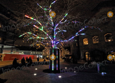 Photo - London UK Peoples Tree Kings Cross Londons newest creative neighbourhood launched its traditionally untraditiona Christmas Kings Cross has become known for its unconventional take on Christmas and 2020 is just as extraordinarySet throughout the Kings Cross neighbourhood are three iconic Christmas trees each delivering an alternative unexpected interpretation of the traditional festive tree Granary Square plays host to the Electric Nemeton Tree designed by local architecture practice Sam Jacob StudioIn Coal Drops Yard sits the Terrarium Tree a sustainable creation comprised of 70 living Botanical Boys terrariums and in Battle Bridge Place is the Peoples Tree an interactive multi-coloured installation illuminated by the steps and sensory movements of visitors Kings Cross London November 25th 2020Ref LMK73-J6700-261120Keith MayhewLandmark MediaWWWLMKMEDIACOM