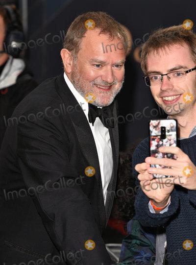 Hugh Bonneville Photo - London UK  Hugh Bonneville at the World Premiere of Downton Abbey held at Cineworld Leicester Square London on Monday 9 September 2019Ref LMK392-J5420-100919Vivienne VincentLandmark Media WWWLMKMEDIACOM