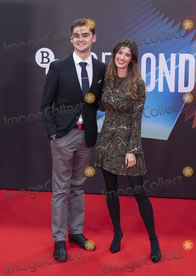 Photo - London UK  Henry Bird and Alice Fevronia at  the UK Premiere of  Mothering Sunday during the 65th London Film Festival at The Royal Festival Hall 14th October 2021 RefLMK386-S3020-131021Gary MitchellLandmark Media WWWLMKMEDIACOM