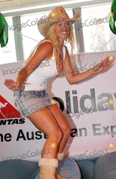 Annalise Braakensiek Photo - London Former Test cricket star Phil Tufnell and Annalise Braakensiek ex-Home and Away star launch a one-off charity cricket match to mark Fosters Australia Day celebrations Trafalgar Square26 January 2005Ali KadinskyLandmark Media