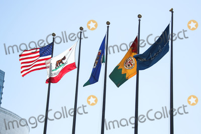 Angel City Photo - LOS ANGELES CALIFORNIA USA - MARCH 26 Flags of the United States California Republic County of Los Angeles City of Los Angeles and Los Angeles Convention Center displayed at Los Angeles Convention Center which is temporarily closed amid the coronavirus COVID-19 pandemic after the Safer at Home order issued by both Los Angeles Mayor Eric Garcetti at the county level and California Governor Gavin Newsom at the state level on Thursday March 19 2020 which will stay in effect until at least April 19 2020 March 26 2020 in Los Angeles California United States (Photo by Xavier CollinImage Press Agency)