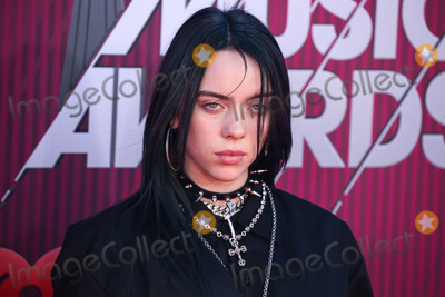 Photo - LOS ANGELES CA USA - MARCH 14 Singer Billie Eilish arrives at the 2019 iHeartRadio Music Awards held at Microsoft Theater at LA Live on March 14 2019 in Los Angeles California United States (Photo by Xavier CollinImage Press Agency)