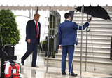 The White Photo - An aide holds an umbrella for United States President Donald J Trump as he departs the White House Saturday June 20 2020 in Washington DC Trump is attending a Make America Great Again campaign rally in Tulsa Oklahoma the first since the outbreak of the coronavirus pandemic postponed much of his 2020 reelection campaign last spring  Credit Mike Theiler  Pool via CNPAdMedia
