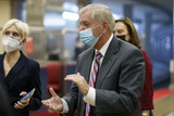 Senator Lindsey Graham Photo - Senator Lindsey Graham a Republican from South Carolina wears a protective mask while walking through the Senate Subway at the US Capitol in Washington DC US on Thursday Feb 11 2021 House prosecutors used the second day of Donald Trumps impeachment trial to detail a months-long campaign by the former president to stoke hatred and encourage violence over the election results that they said culminated in the mob attack on the US Capitol that he then did little to stop Credit Ting Shen - Pool via CNPAdMedia
