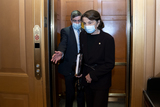 Senator Dianne Feinstein Photo - Senator Dianne Feinstein a Democrat from California right wears a protective mask while departing the US Capitol in Washington DC US on Saturday Feb 13 2021 Donald Trumps second impeachment trial ended in a not guilty verdict on a vote of 57-43 short of the two-thirds majority required Credit Stefani Reynolds - Pool via CNPAdMedia