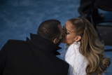 Kiss Photo - UNITED STATES - January 20 Jennifer Lopez kisses fianc Alex Rodriguez after performing during the inauguration of Joe Biden on the West Front of the US Capitol in Washington on Wednesday Jan 20 2021 (Photo by Caroline BrehmanCQ Roll Call)AdMedia