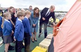 David Attenborough Photo - 26092019 - Prince William Duke of Cambridge and Duchess of Cambridge stand with school children as the inspect a liferaft on the deck during the naming ceremony of Britains new polar research ship the RRS Sir David Attenborough at Camel Laird Shipyard in Birkenhead Merseyside Photo Credit ALPRAdMedia