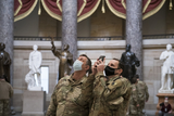 The National Photo - Members of the National Guard take photos in Statuary Hall of the US Capitol as the House of Representatives vote on H Res 24 Impeaching Donald John Trump President of the United States for high crimes and misdemeanors at the US Capitol in Washington DC Wednesday January 13 2021 Credit Rod Lamkey  CNPAdMedia