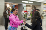 The Interns Photo - A woman is given a bouquet of flowers as she arrives from Dubai after a 14-hour flight on Emirates flight 231 at the international terminal at Dulles International Airport in Dulles Va Monday March16 2020 Some people are taking the precaution of wearing face masks as they arrive to be greeted by family and or friends Credit Rod Lamkey  CNPAdMedia