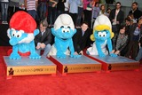 Papa Smurf Photo - 13 December 2011 - Hollywood California - Papa Smurf Bob Osher Clumsy Smurf Anton Yelchin Smurfette The Smurfs Hand and Footprint Ceremony held at Graumans Chinese Theatre Photo Credit Byron PurvisAdMedia