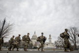 The National Photo - Members of the National Guard walk past the US Capitol as preparations are made for the upcoming inauguration of President Joe Biden at the US Capitol in Washington DC Friday January 15 2021 Credit Rod Lamkey  CNPAdMedia
