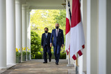 Joe Biden Photo - United States President Joe Biden and The Prime Minister of Japan  HE Suga Yoshihide walk on the Colonnade prior to their joint news conference at the White House Friday April 16 2021 Credit Doug Mills  Pool via CNPAdMedia