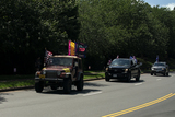 American Flag Photo - Vehicles display American flags and flags showing support for United States President Donald J Trump as they drive past Trump National Golf Club in Sterling Virginia US on Sunday August 23 2020  Trump is expected to kick off the Republican National Convention with a speech in Charlotte North Carolina on Monday and officially accept the Republican nomination from the White House lawn on Thursday  Credit Stefani Reynolds  Pool via CNPAdMedia