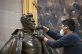 Andrew Jackson Photo - A man works on cleaning up a statue of former President Andrew Jackson in the Rotunda at the US Capitol in Washington DC Tuesday January 12 2021 Credit Rod Lamkey  CNPAdMedia