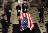American Flag Photo - Democratic Presidential nominee former United States Vice President Joe Biden and his wife Dr Jill Biden pay their respects in front of the American flag draped casket of US Supreme Court Associate Justice Ruth Bader Ginsburg as she lies in state at the US Capitol on September 25 2020 in Washington DC Ginsburg who was appointed by former US President Bill Clinton served on the high court from 1993 until her death on September 18 2020 She is the first woman to lie in state at the CapitolCredit Chip Somodevilla  Pool via CNPAdMedia