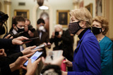 Donald Trump Photo - Senator Elizabeth Warren a Democrat from Massachusetts wears a protective mask while speaking to members of the press at the US Capitol in Washington DC US on Saturday Feb 13 2021 The Senate voted to consider a request for witnesses at Donald Trumps impeachment trial injecting a chaotic new element that could end up prolonging proceedings that appeared to be on track to wrap up today Credit Ting Shen - Pool via CNPAdMedia