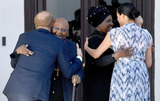 Archbishop Desmond Tutu Photo - Prince Harry Duke of Sussex Meghan Markle Duchess of Sussex and son Archie Harrison Mountbatten-Windsor with Archbishop Desmond Tutu and his daughter Thandeka during a visit to the Desmond  Leah Tutu Legacy Foundation in Cape Town South Africa Photo Credit ALPRAdMedia