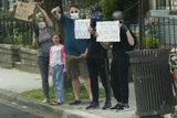 John Paul Photo - Protesters demonstrate along the route taken by United States President Donald Trump and First lady Melania Trump to visit the Saint John Paul II National Shrine in Washington DC on Tuesday June 2 2020Credit Chris Kleponis  Pool via CNPAdMedia