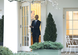 Barack Obama Photo - President Barack Obama leaves the Oval Office for the last time as President in Washington DC on January 20 2017 Later today President-Elect Donald Trump will be sworn-in as the 45th President Photo Credit Kevin DietschCNPAdMedia