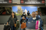 The Interns Photo - Passengers arrive from Dubai after a 14-hour flight on Emirates flight 231 at the international terminal at Dulles International Airport in Dulles Va Monday March16 2020 Some people are taking the precaution of wearing face masks as they arrive to be greeted by family and or friends Credit Rod Lamkey  CNPAdMedia