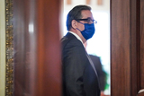 President Trump Photo - Bruce Castor Jr attorney for former President Donald Trump heads into a meeting room as the Senate determines whether to hear from witnesses during the fifth day of the impeachment trial of former President Trump on Saturday February 13 2021Credit Greg Nash - Pool via CNPAdMedia