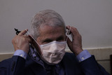 Anthony Fauci Photo - Dr Anthony Fauci Director of the National Institute of Allergy and Infectious Diseases at the National Institutes of Health puts on a mask after making a statement as he  participates in a briefing with members of the White House Coronavirus Task Force at the White House in Washington DC November 19 2020 Credit Chris Kleponis  Pool via CNPAdMedia