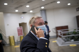 The Used Photo - United States Senator Lindsey Graham (Republican of South Carolina) talks on a phone as he makes his way through the Senate subway following a vote at the US Capitol in Washington DC Wednesday October 21 2020 Credit Rod Lamkey  CNPAdMedia