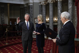 Alabama Photo - United States Senator Tommy Tuberville (Republican of Alabama) the former Auburn University football coach is joined by his wife Suzanne Tuberville as he takes the oath of office from Vice President Mike Pence during a reenactment ceremony in the Old Senate Chamber at the Capitol in Washington Sunday Jan 3 2021 Credit J Scott Applewhite  Pool via CNPAdMedia