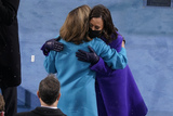 Nancy Pelosi Photo - Vice President-elect Kamala Harris and House Speaker Nancy Pelosi of Calif embrace as they arrive for the 59th Presidential Inauguration at the US Capitol in Washington Wednesday Jan 20 2021 (AP PhotoSusan Walsh Pool)AdMedia