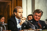Kennedy Photo - United States Senator Joseph Biden (Democrat of Delaware) Chairman US Senate Committee on the Judiciary makes remarks as he chairs the confirmation vote for Judge Robert Bork US President Ronald Reagans nominee to succeed Associate Justice of the Supreme Court Louis Powell on Capitol Hill in Washington DC on October 6 1987  US Senator Edward M Ted Kennedy (Democrat of Massachusetts) looks on from rightCredit Ron Sachs  CNPAdMedia