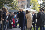 Kiss Photo - United States President Donald J Trump kisses a young girl while taking a photo with her on the South Lawn of the White House in Washington DC US as he departs for a day trip to Marietta Georgia on Friday November 8 2019  Credit Stefani Reynolds  CNPAdMedia