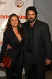 Yasmine Bleeth Photo - Yasmine Bleeth and husband Paul Cerrito at the Valentines Engagement Party for Carmen Electra and Dave Navarro The Lounge West Hollywood CA  02-13-03