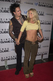 Donna DErrico Photo -  NIKKI SIXX and DONNA DERRICO at the launch party for the new Nintendo Game Cube system sponsored by MTV in Hollywood 10-03-01