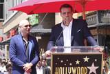 Tony Robbins Photo - Pitbull Tony Robbinsat the Pitbull Star on the Hollywood Walk of Fame Ceremony Hollywood CA 07-15-16