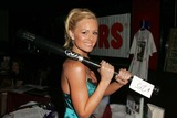 Auction Items Photo - Katie Lohmann with auction itemsat the 1st Annual Holiday Hooters Concert benefitting the Haven Hills Battered Women and Childrens Shelter Xes Hollywood CA 12-07-05