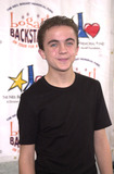 Frankie Muniz Photo - Frankie Muniz at the 2001 Bogart Backstage concert gala fundraiser for the Neil Bogart Memorial Fund Barker Hanger Santa Monica 11-11-01