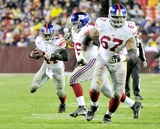 Chris Snee Photo - RESTRICTED NO NEW YORK OR NEW JERSEYNEWSPAPERS WITHIN A 75 MILE RADIUS OF NYC01022011 - GIANTS V REDSKINSNew York Giants running back Ahmad Bradshaw (44) follows his blockers Chris Snee (76) and Kareem McKenzie (67) in fourth quarter action against the Washington Redskins at FedEx Field in Landover Maryland on Sunday January 2 2011  The Giants won 17 - 14Photo by Ron SachsCNP-PHOTOlinknet