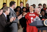 Nick Saban Photo - United States President Barack Obama (R) receives a jersey as head coach Nick Saban (L) and offenisve line Mike Johnson (2nd L) look on during an East Room event to host members of the Alabama Crimson Tide Monday March 8 2010 at the White House in Washington DC Obama welcomed the 2009 BCS Champions to honor its 13th championship and an undefeated season  Photo by Alex WongPool-CNP-PHOTOlinknet